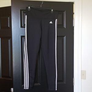 Nwot adidas leggings black with white stripes.